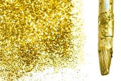 Guld- gnistrandetextur Abstrakt guld- blänker bakgrund Guld M Arkivfoto