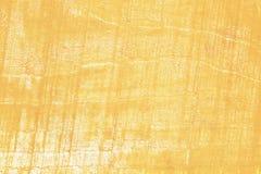 Guld- grunge målad wood textur Royaltyfri Bild