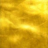 guld- grungetextur Arkivbild