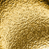 Guld- grungy bakgrund Arkivfoto