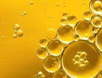 Guld- gul bubblaolja arkivfoto