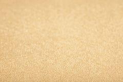 Guld- guling blänker bakgrund Arkivfoton