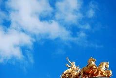 guld- hästar Arkivfoto