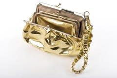 guld- handväska arkivbild
