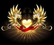 Guld- hjärta med guld- vingar Arkivbild