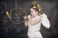 guld- horn för cupids Arkivfoto