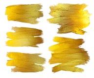 Guld- illustration för uppsättning för texturmålarfärgfläck Hand drog beståndsdelar för borsteslaglängddesign Abstrakt texturerat Arkivfoto