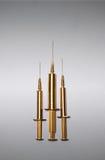 Guld- injektionssprutor Royaltyfri Fotografi