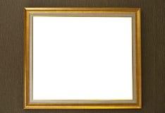 Guld- inrama på pappers- bakgrund Arkivbild
