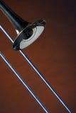 guld isolerad tromboneyellow fotografering för bildbyråer