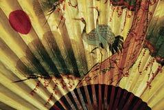 Guld- japansk fan royaltyfri foto