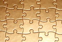 guld- jigsaw royaltyfri foto