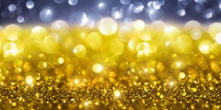 Guld- jul blänker bakgrund Royaltyfria Bilder
