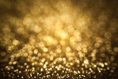 Guld- jul gör sammandrag bakgrund, det festliga kortet, guld- bokeh Arkivbild