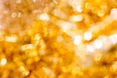 Guld- julBokeh bakgrund Guld- ferie som glöder abstrakt, blänker Defocused bakgrund Royaltyfria Foton