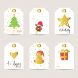 Guld- juletikett med hjärta och stjärnan Arkivfoto