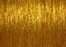 Guld- julglitterbakgrund Royaltyfri Foto