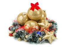 Guld- julgranbollar och kran Royaltyfria Bilder
