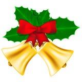 Guld- julklockor med sidor av järnek Royaltyfria Bilder