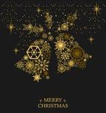 Guld- julklockor med snöflingor på en svart bakgrund Ho Royaltyfria Bilder