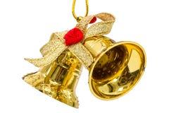 Guld- julklockor som isoleras på vit bakgrund Royaltyfri Fotografi