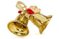 Guld- julklockor som isoleras på vit bakgrund Arkivbilder