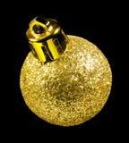 Guld- julprydnad som isoleras på svart bakgrund Royaltyfria Foton