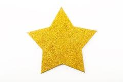 Guld- julstjärnaprydnad som isoleras på vit Arkivfoto