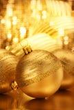 Guld- julstruntsak Arkivfoton