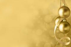 Guld- julstruntsakbakgrund Fotografering för Bildbyråer