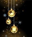Guld- julstruntsaker Royaltyfria Bilder