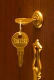 guld- key framgång Arkivbild