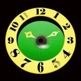 Guld- klocka på en svart bakgrund Arkivbild