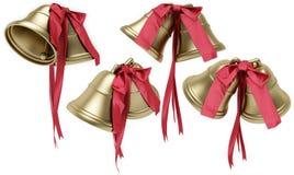 Guld- klockor med en röd bow Fotografering för Bildbyråer