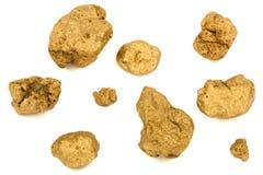 Guld- klumpar som isoleras på vit bakgrund Arkivfoton