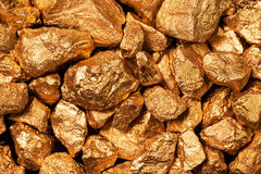 Guld- klumpcloseup. Arkivfoton