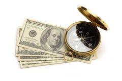 Guld- kompass och dollar Arkivfoto