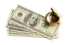 Guld- kompass och dollar Arkivbilder