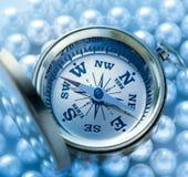 Guld- kompass på pärlan Royaltyfria Bilder