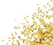 Guld- konfettier Arkivfoto