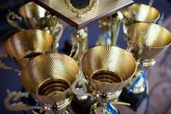 Guld- kopp för vinnare 1st ställebelöning Arkivfoton