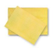 Guld- kort och kuvert. arkivfoton