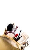 Guld- kosmetisk påse Royaltyfri Fotografi