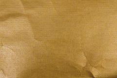 guld- kraft papper royaltyfri bild