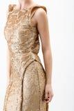 guld- kvinnabarn för klänning Arkivfoton