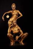 Guld- Bodyart. Färga. Guld- kvinnaSilhouettes med Retro vinylrekord över svart. Idérikt konstbegrepp royaltyfri fotografi