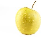 Guld- - läckert äpple på vit bakgrund royaltyfri foto