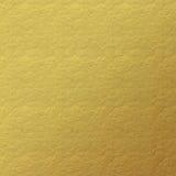 Guld- lädertexturbakgrund Arkivbild