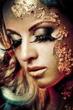 guld- lady arkivbild