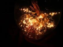 guld- lampor för jul arkivbild